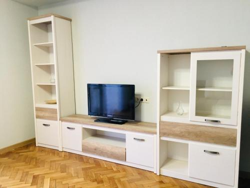 A television and/or entertainment centre at Victory Park Apartments