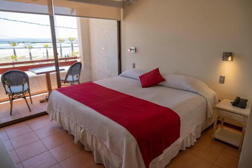 Cama o camas de una habitación en Hotel Canto del Mar