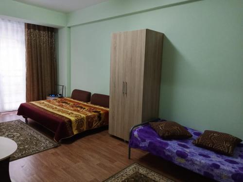 Кровать или кровати в номере Studio in Estosadok