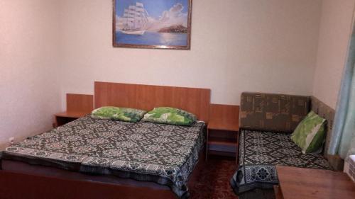 Кровать или кровати в номере Na Kalinina Guest Room