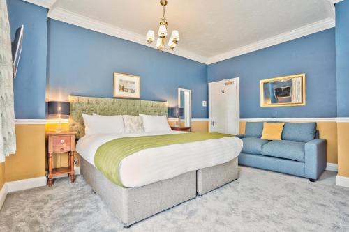 A bed or beds in a room at The Yewdale Inn