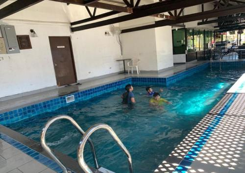 The swimming pool at or near Nipah Bay Villa
