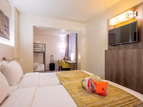 Ein Bett oder Betten in einem Zimmer der Unterkunft Mercure Oostende