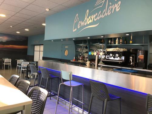 Restaurant ou autre lieu de restauration dans l'établissement Hôtel L'Embarcadère