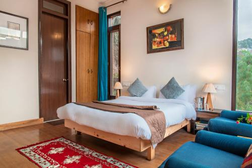 A bed or beds in a room at Kasauli's Bottom