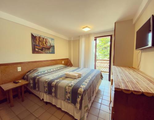 A bed or beds in a room at Pousada Manga Rosa Beira Mar
