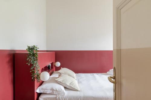 Letto o letti in una camera di iFlat Sunny and Colorful Esquilino Apartment