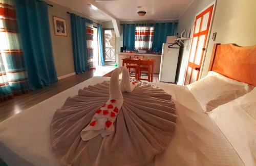 A bed or beds in a room at Castara Inn