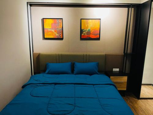 A bed or beds in a room at MARITIME WATERFRONT