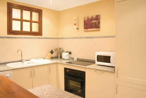 Una cocina o zona de cocina en Las Sierras 132