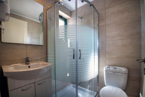 Een badkamer bij Palatia Village Hotel Apartments