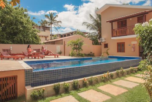 The swimming pool at or close to Villa das Palmeiras