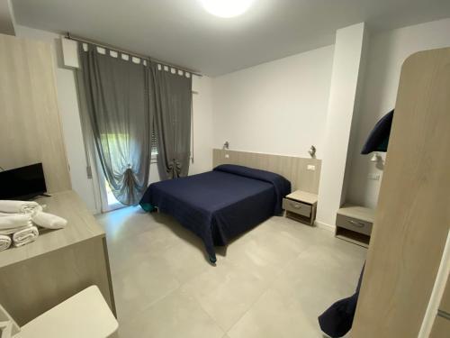 Ein Bett oder Betten in einem Zimmer der Unterkunft Hotel Garnì Lele