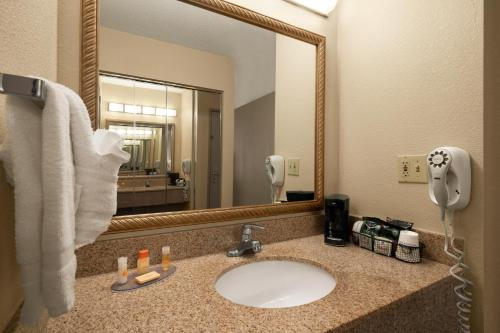 A bathroom at Days Inn & Suites by Wyndham Omaha NE