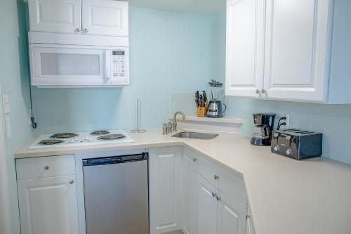 A kitchen or kitchenette at Sea and Breeze Hotel and Condo