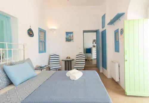 A bed or beds in a room at Casa Annaise Mykonos - Cycladic House with Jacuzzi