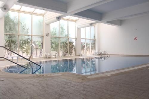 The swimming pool at or near Borj Dhiafa