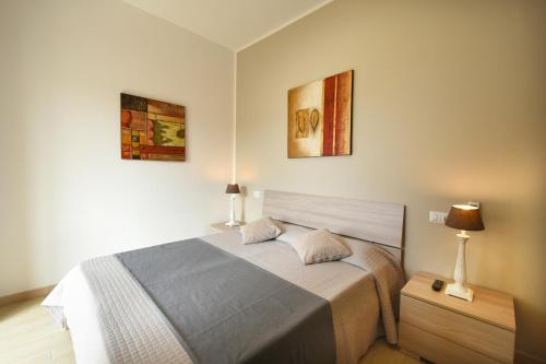 A bed or beds in a room at Affittacamere La Suite dei Graniti