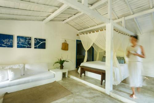 A bed or beds in a room at Pousada Lagoa