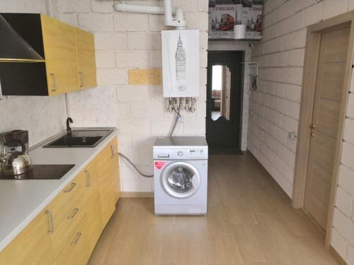 Кухня или мини-кухня в Апартаменты Пляж на Крымской