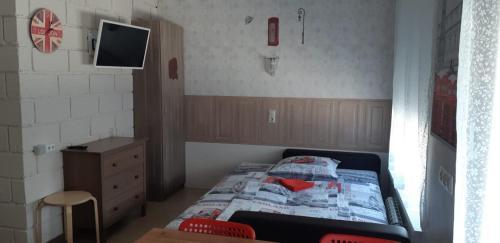 Кровать или кровати в номере Апартаменты Пляж на Крымской