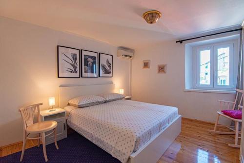 Krevet ili kreveti u jedinici u objektu Apartments and Rooms Ille