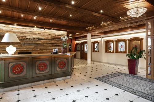 Hol lub recepcja w obiekcie Alpejski Boutique Hotel