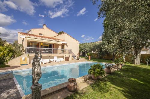 The swimming pool at or near Villa Noria