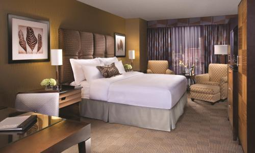 A bed or beds in a room at New York New York