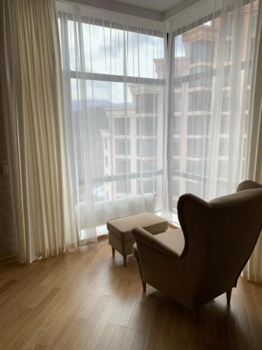 Гостиная зона в Green Park Apartment 285