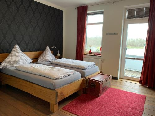 A bed or beds in a room at Kanal 33