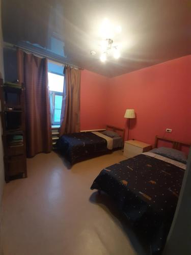 Кровать или кровати в номере Хостел Республика