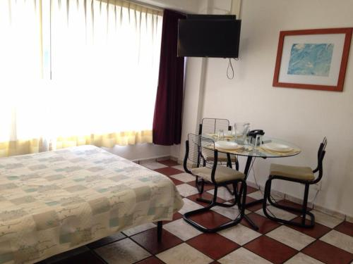 A bed or beds in a room at Apartamentos Hotel Avilla