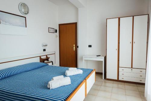 Letto o letti in una camera di Hotel Montecarlo