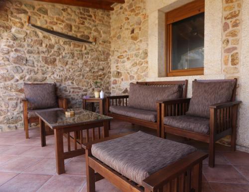 A seating area at Casal Pedrajás
