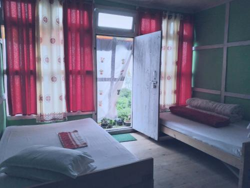 A bed or beds in a room at Window view Homestay Charkhol