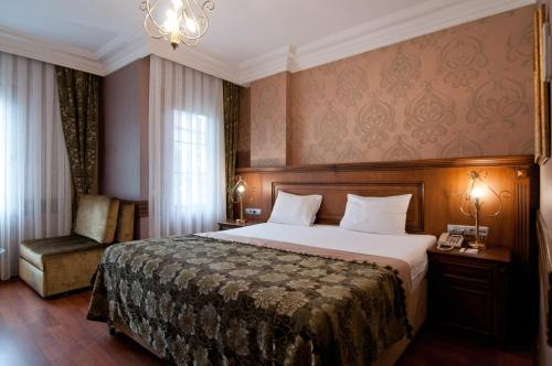 A bed or beds in a room at Ferman Hotel Old City -Special Category