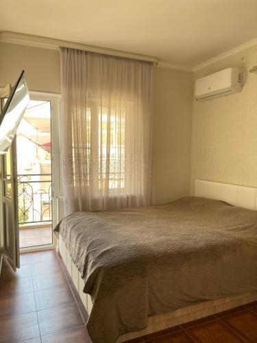 Кровать или кровати в номере Гостевой дом Лариса