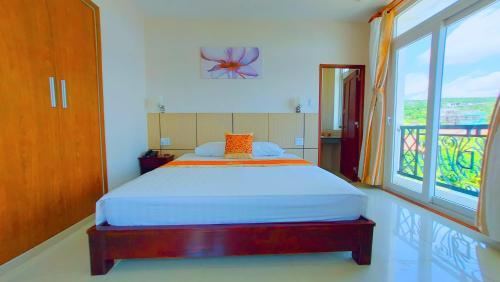 Кровать или кровати в номере Victoria Phu Quoc hotel