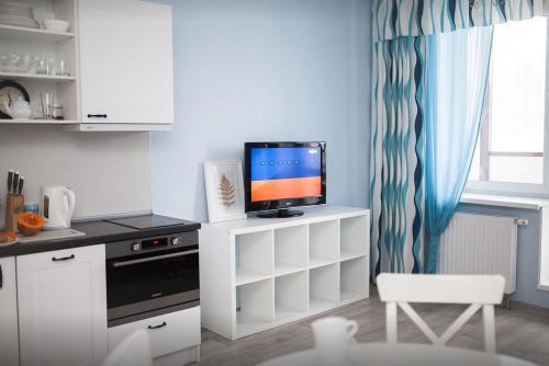 Телевизор и/или развлекательный центр в Elegant Apartment