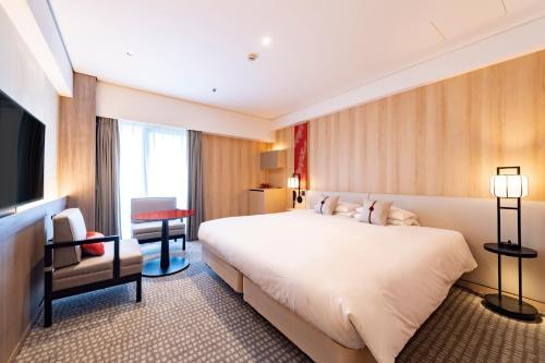 Un ou plusieurs lits dans un hébergement de l'établissement Kyoto Tokyu Hotel