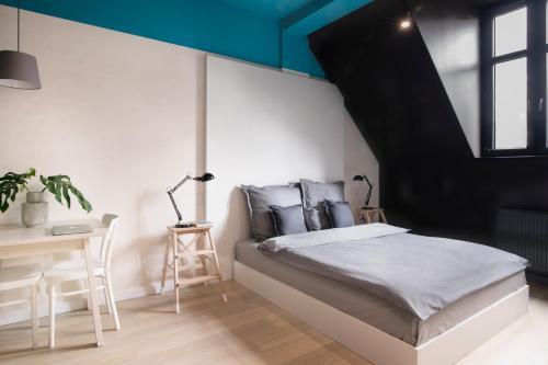 Łóżko lub łóżka w pokoju w obiekcie Bike'UP Wrocław