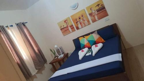 A bed or beds in a room at House Rental Banaba Tree