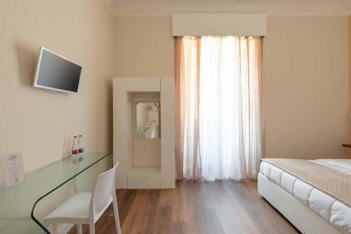Televízia a/alebo spoločenská miestnosť v ubytovaní TERMINI Smart ROOMS