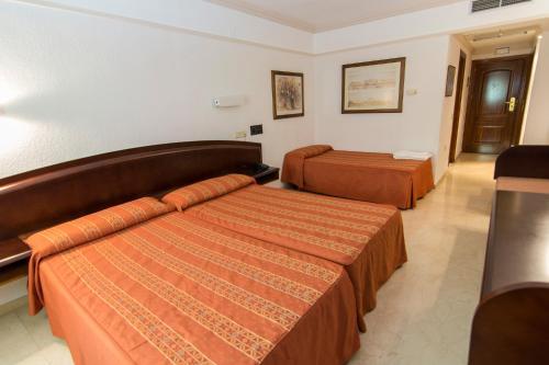 Cama o camas de una habitación en Hotel Europa