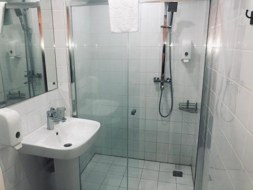 Ванная комната в Апарт-отель Наумов