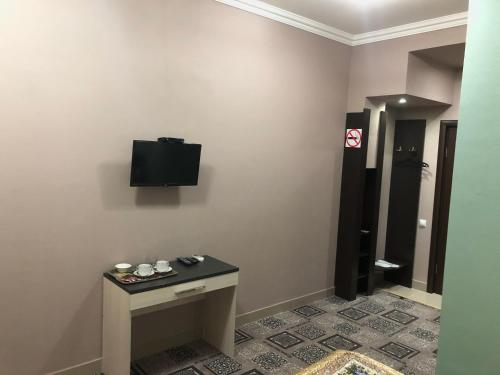 Телевизор и/или развлекательный центр в Guest House Dzerzhinsky