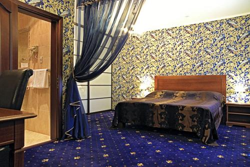 Кровать или кровати в номере Гостевой Дом Сибирский