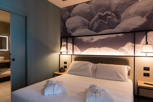 Letto o letti in una camera di Modica Boutique Hotel