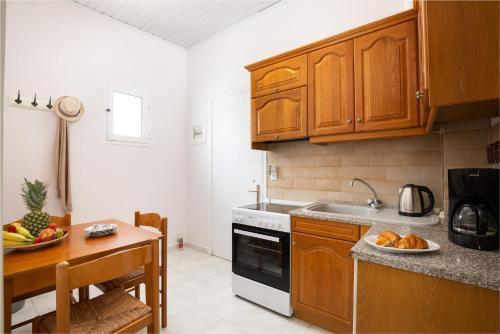 A kitchen or kitchenette at Dandidis Seaside Pension